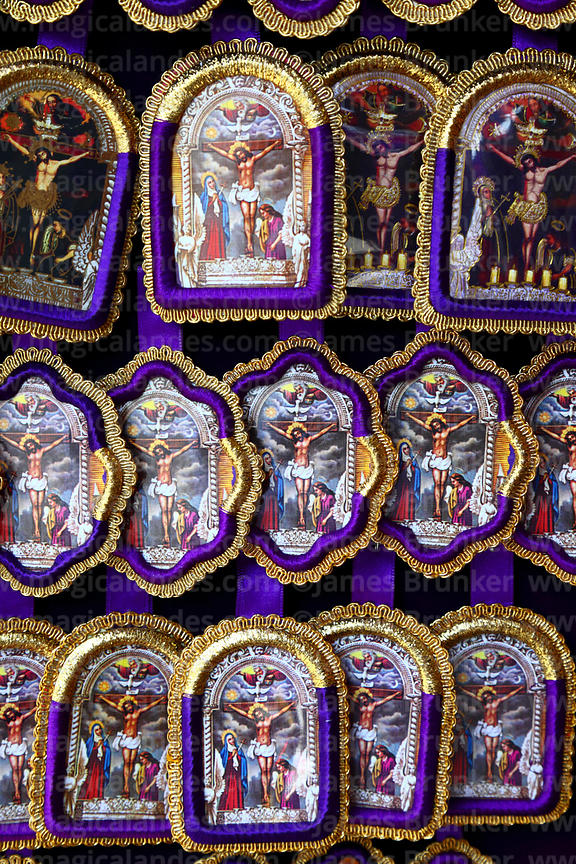 Embroidered Señor de los Milagros icons for sale in shop, Lima, Peru