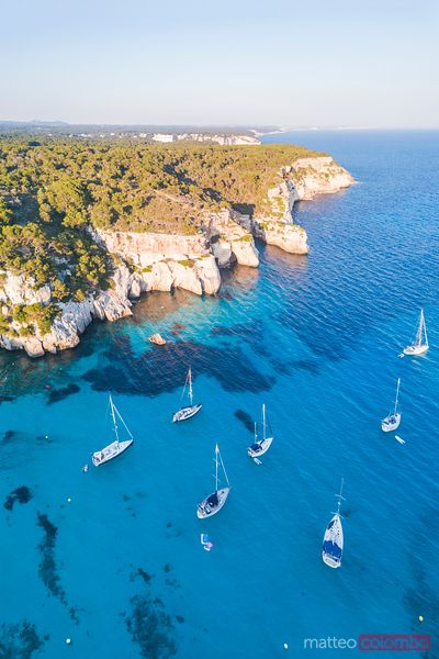 Aerial of bay and yachts, Cala Macarella, Baleares