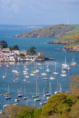Boats moored in sheltered waters of Fowey Estuary near Polruan, Cornwall, England, UK. May 2015.