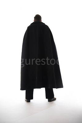 A mystery man in a cloak, in silhouette – shot from low level.