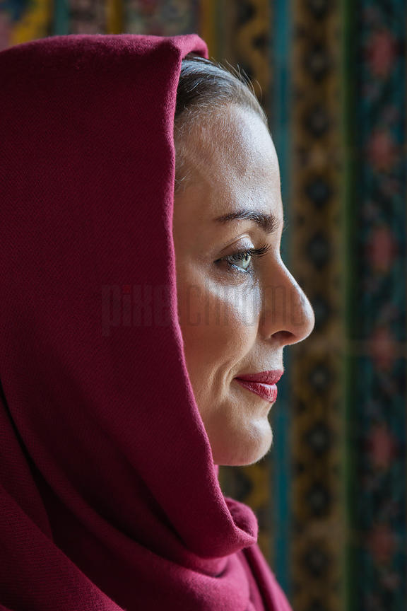 Portrait of a Woman Wearing a Pink Shawl at the Pink Mosque