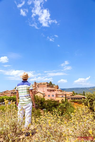 Man looking at the town of Roussillon, Provence, France