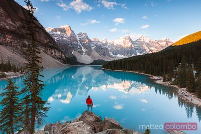 Tourist looking at Moraine lake, Banff National Park, Canada