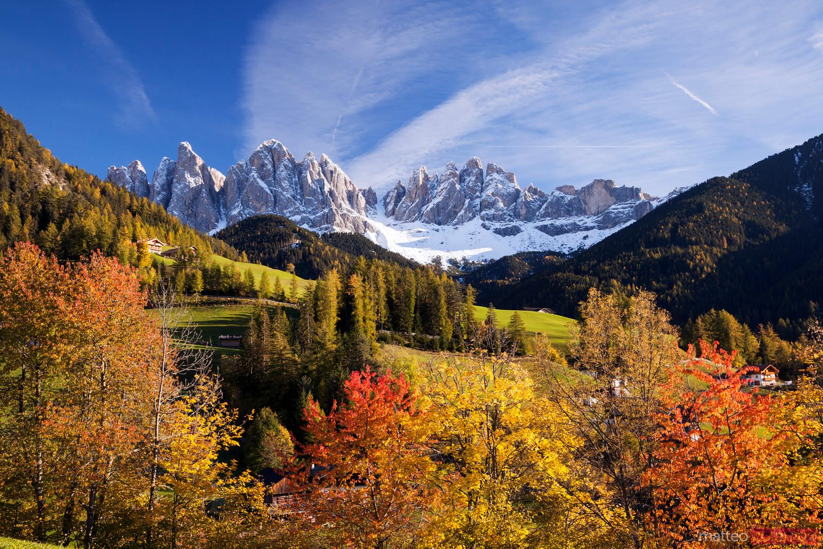 Funes valley in autumn with Odle peaks Dolomites Italy