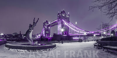 The Dolphin fountain near Tower Bridge covered in snow, London