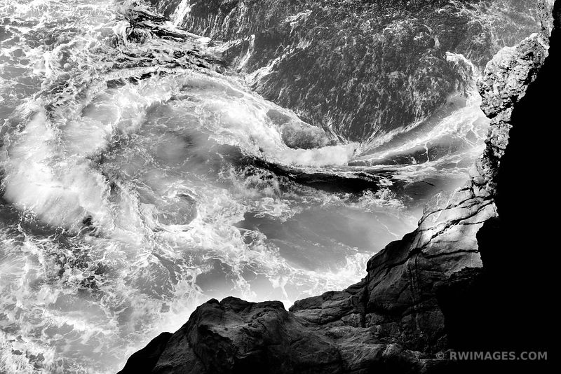 WAVES SWIRLING BY THE ROCKY SHORE BIG SUR CALIFORNIA BLACK AND WHITE