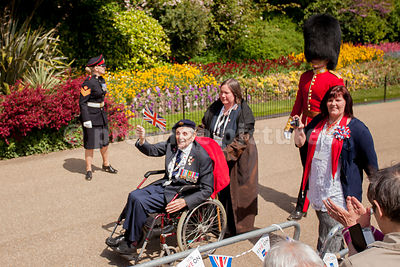 World War 2 Veteran Waving a Union Jack Flag in the VE Day Veteran's Parade