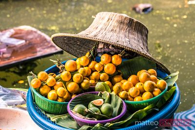Oranges for sale at floating market, Bangkok, Thailand