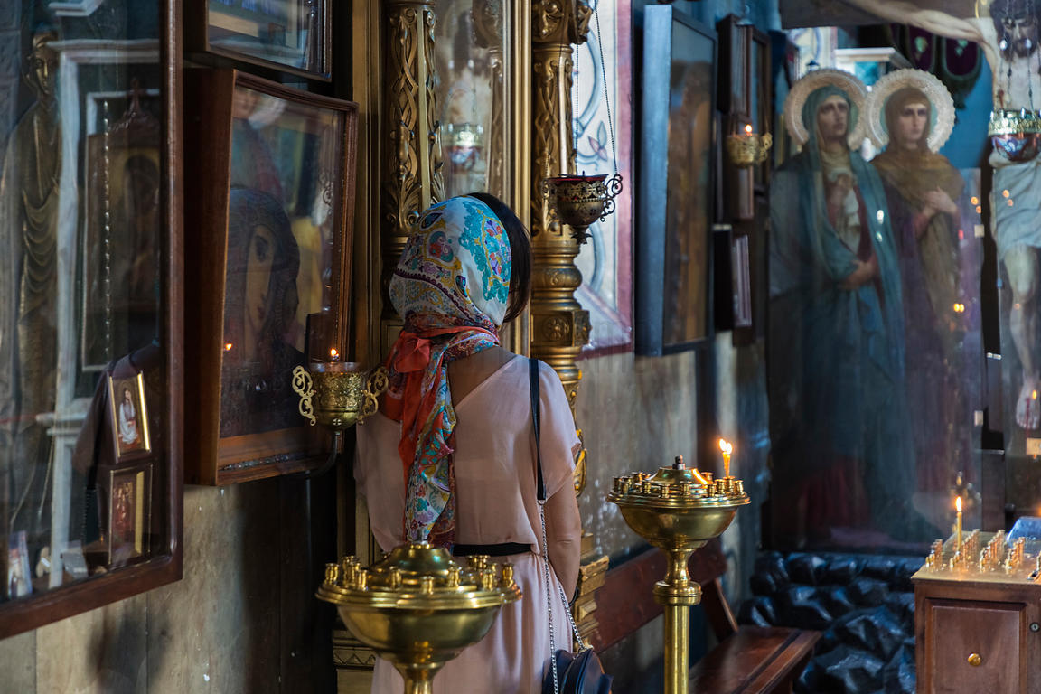 Woman Praying at St. Nicholas Orthodox Church