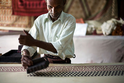 India - Rajasthan - Kunj Bihari Darbar, 65, a master printer prints on fabric using wooden blocks