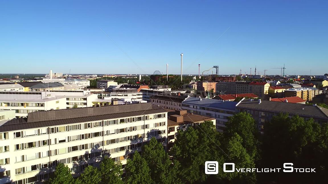 Helsinki City, Uhd Aerial Rising View Kallio and Linnanmaki Amusement Park, on a Sunny Summer Morning Dawn, in Helsingfors, U...