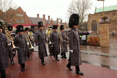 The Queen's Division Band in grey coats approach the Cathedral