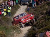 a Ford Escort leaps up the start of the last steep hill on the Blue Hills section of the MCC Land's End Trials