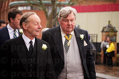 Two Men Wearing White Roses & Waistcoats
