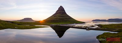 Panoramic drone view of mount Kirkjufell reflected at sunset, Iceland