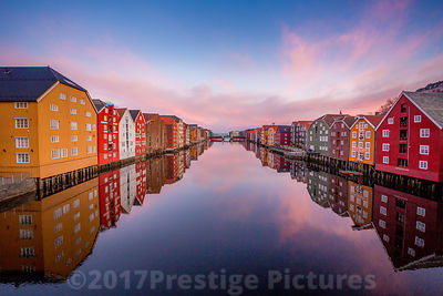 Wooden Buildings on Stilts in Trondheim at sunrise - Stock photo Trondheim
