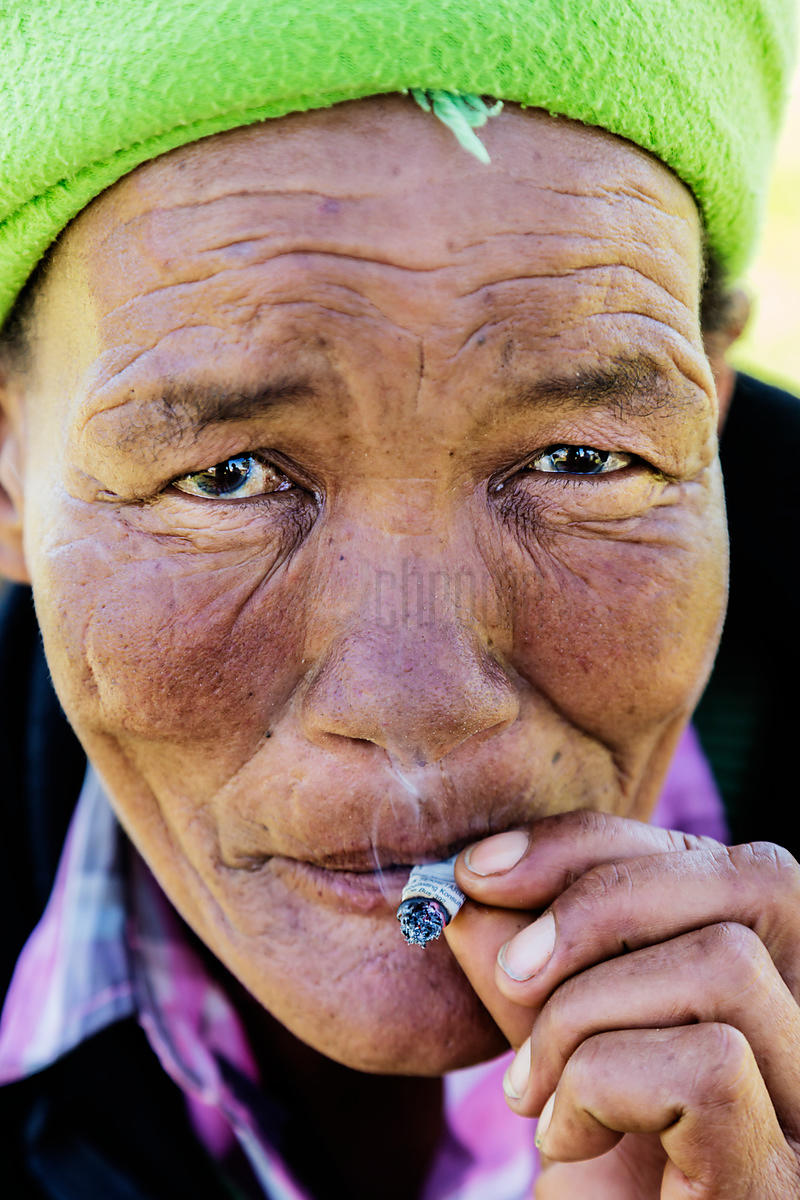 Portrait of a Nama Woman Smoking a Hand Made Cigarette
