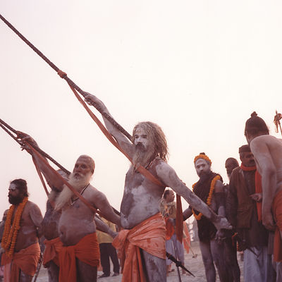 Saddhus and ceremonial staves at the Kumbh Mela