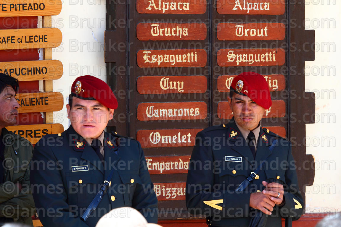 Police on duty in front of menu outside restaurant during festival parade, Puno, Peru