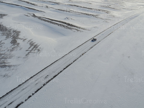 A 4x4 off-road truck driving skidding on an icy road in Iceland
