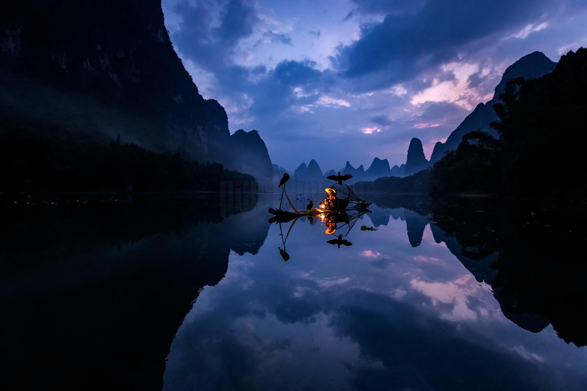 Fisherman on the Li River at Dawn