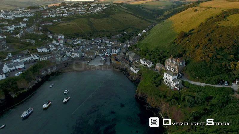 Drone pulls back at height to reveal the harbor of Port Isaac in Cornwall