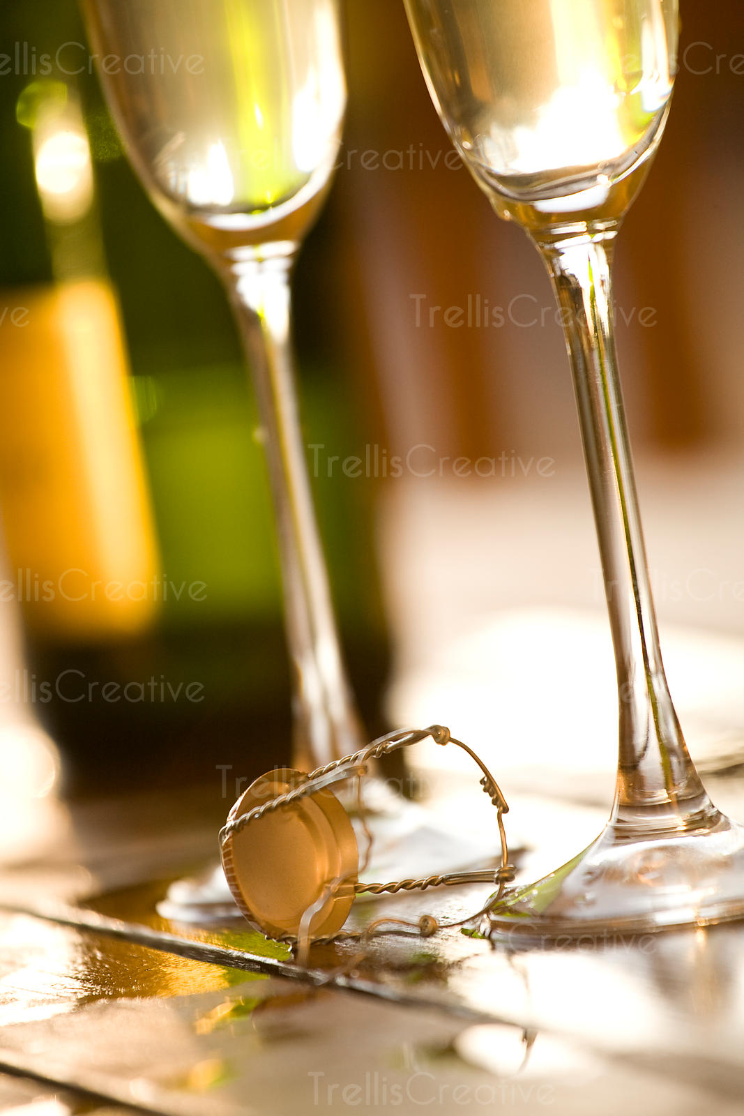 Close-up of two champagne flutes filled with sparkling wine