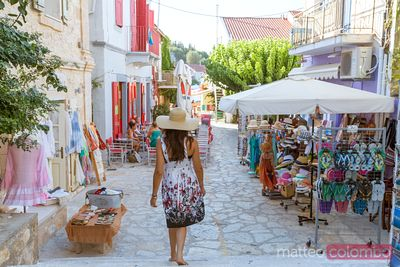 Woman shopping in Kefalonia, Greek Islands, Greece