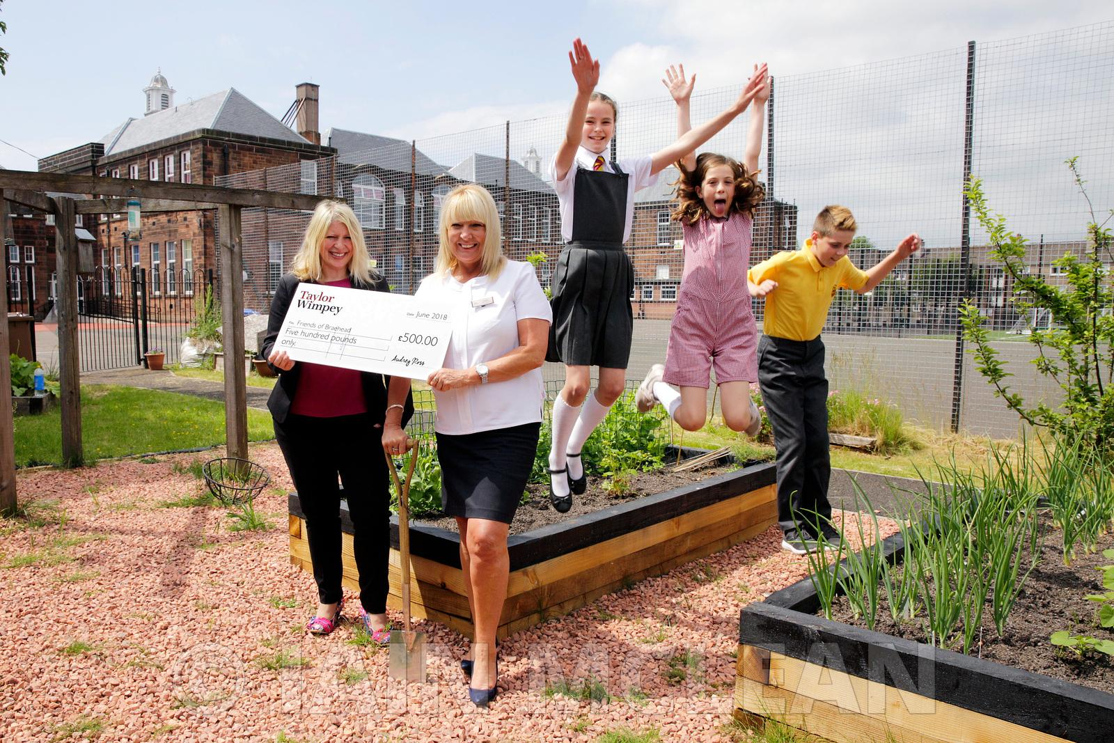 Taylor Wimpey at Braehead Primary School, Dumbarton..8.6.18.TW Sales Exec Lorraine Scouller (TW The Fairways development, whi...