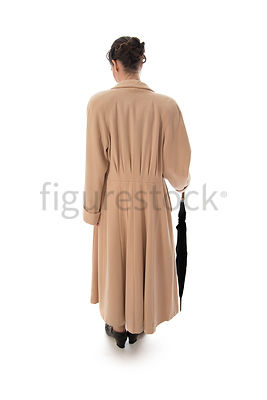 A vintage 1920s - 1930s woman in a big coat – shot from eye level.