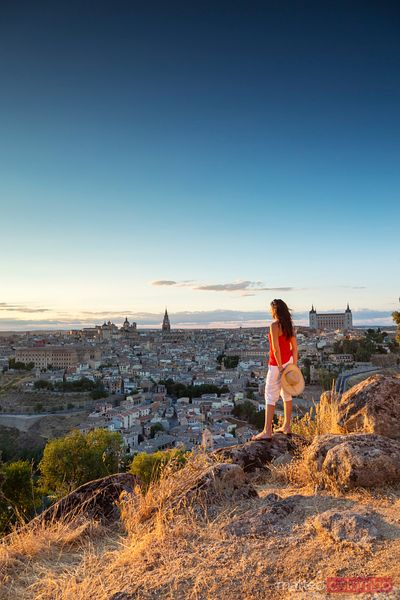 Woman looking at the city at sunset, Toledo, Spain