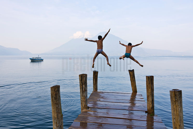 Boys Jumping off a Boat Dock into Lake Atitlan