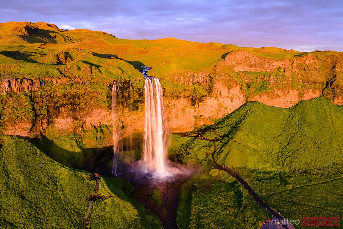 Aerial drone view of Seljalandsfoss waterfall at sunset, Iceland