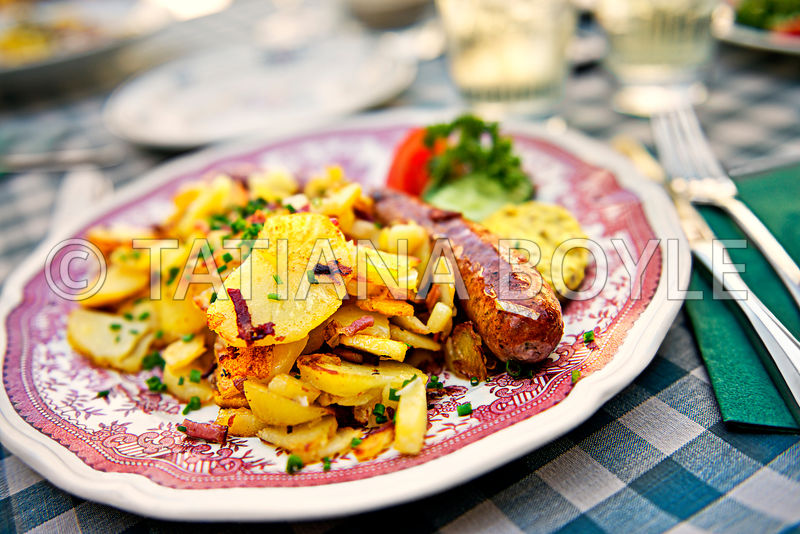 Grilled brätwurst and fried potatoes