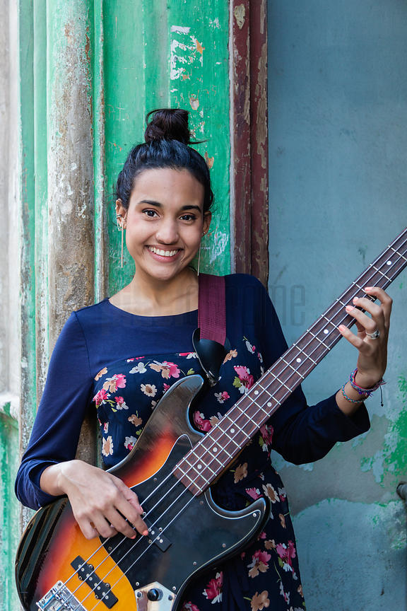 Portrait of a Musician with her Bass Guitar