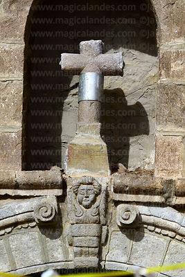 Stone cross and carved human face above main entrance of colonial church, Ayo Ayo, La Paz Department, Bolivia