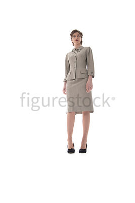 A 1940's /1950's woman in a suit – shot from low-level.