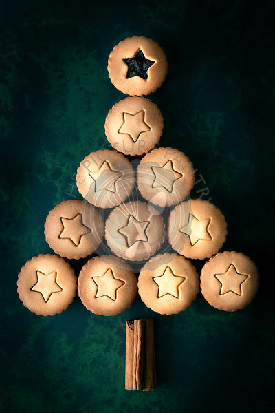A Christmas tree made using gingerbread fruit mince pies and cinnamon sticks.