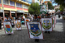 College group parades through streets holding badges of Bolivia's Departments for Dia del Mar / Day of the Sea , La Paz , Bol...