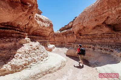 Man hiking in narrow canyon, Utah, USA