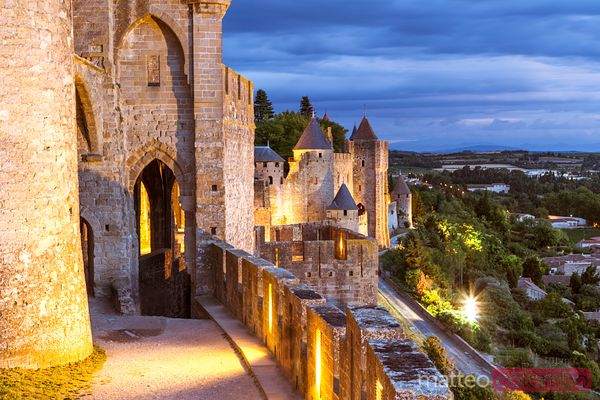 Walls and towers of the old town at dusk, Carcassonne, France