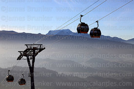 Yellow Line cable car gondolas and Mt Mururata shortyl after sunrise, La Paz, Bolivia