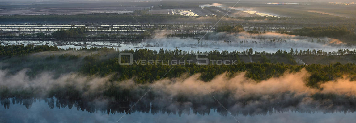 Aerial view over man made peat pit at sunrise, Tartumaa, Estonia, May 2013.