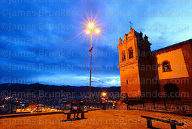 San Cristobal church and plaza with city in background at twilight, Cusco, Peru
