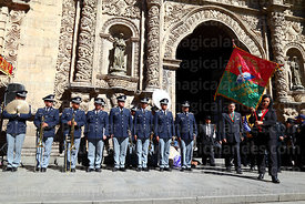 Descendents of the members of the Junta Tuitiva carry a banner out of San Francisco church after mass for a civic ceremony to commemorate the uprising of July 16th 1809, La Paz, Bolivia