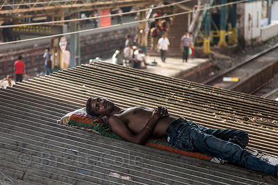 A man sleeps on the roof of the Marine Lines railway station in Mumbai, India.