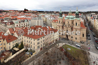 Church of St Nicholas (1732-1737) from Old Town Hall Tower, Old Town Square, with St Vitus's Cathedral on the hill top, Pragu...