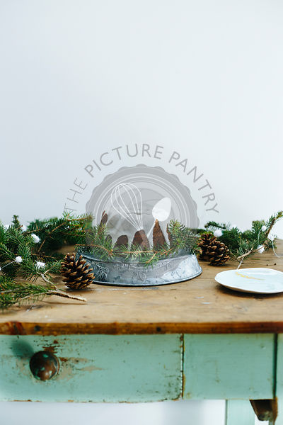 Wintery cake on a blue wooden table