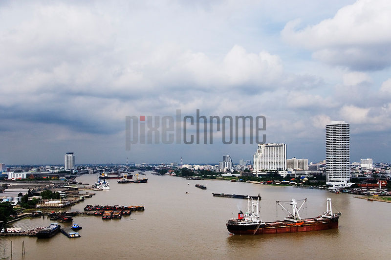 Boat and Barge Traffic on Chao Phraya River Bangkok Thailand