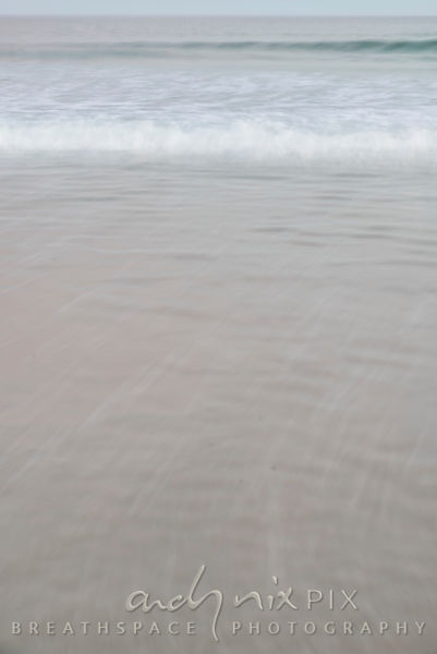 Shallow waves on beach sand